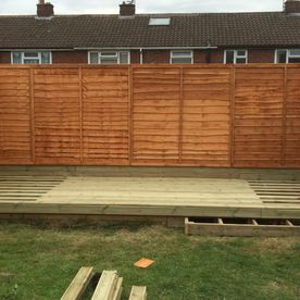 decking that is being laid by our team in a residential garden