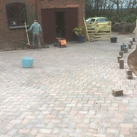 Our team finishing off a block paving task